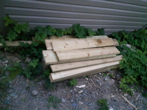"Miscellaneous wood 1"" decking wood and 4x4 post"