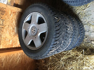 Vw rims and winter studded tires Prince George British Columbia image 1