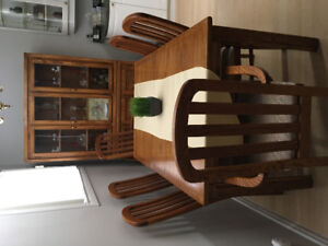 Solid Oak Table with 2 leafs,  6 chairs and China Cabnet.