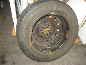 4 used winter tires and rims for 2006 Dodge Caravan