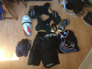 Hockey gear, including everything but helmet, gloves, and skates