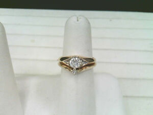 One Lady's 14k Yellow And White Gold Diamond Solitaire Ring Set.
