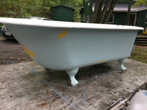 ANTIQUE CAST IRON CLAWFOOT BATHTUB WITH TAPS