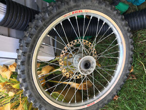 NEW front rim and barely used front tire off 2007 rm-z250