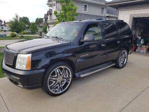 "2003 Super charged Cadillac Escalade on 24"" rims"