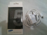 Samsung S5 - Original Flip case and Brand New Charger (Package)
