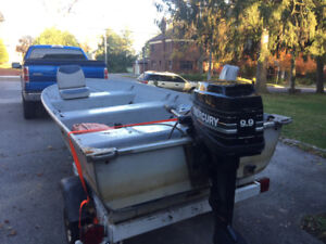 "9.9 Mercury Motor and 12"" Smoker Craft Aluminum fishing boat"
