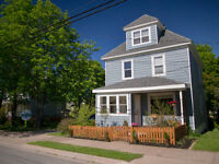 Restored home on double lot, walk to schools & businesses.