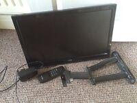 Small Alba flat screen TV with wall bracket and remote