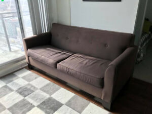 Brown Sofa Bed with Pillows and Mattress