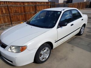 2002 White Mazda Protege Manual Transmission obo