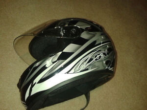 two snow mobile or quad helmets