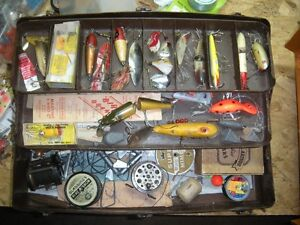old metal tackle box full of vintage fishing lures and content