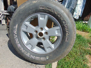 1 tire and mag 235/70/17 like new continental contitrac tire $9