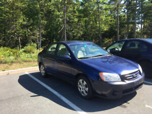 2006 Kia Spectra with Winter Tires and MVI good until May 2019.