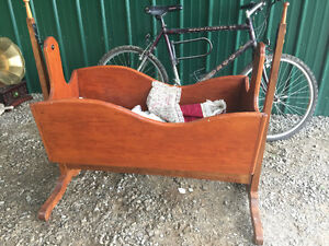 Antique cradle with doll