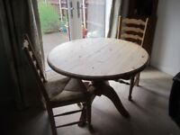 Solid Pine circular table with four chairs & matching corner unit