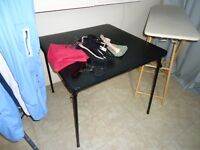 black card table and 4 chairs