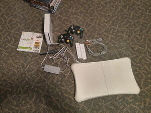 Nintendo Wii with Wii Fit and extra Controllers