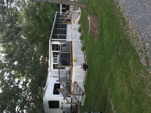 Beautiful 393 Forest River park model trailer with sunroom
