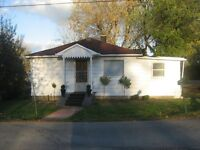 Two bedroom house in village of Wolfe ISland