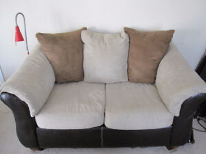 REDUCED!Couch and love seat leather sides with textile cushions