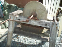 Hand  cranked  grind stone and orginal frame work