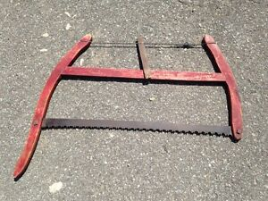 Antique red wood bow saw. farm tree logging tool