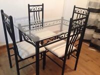 Glass and solid metal Dining Table with 4 chairs