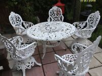Garden table and chairs cast iron read first