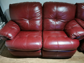 Beautiful two seater sofa (one reclining seat)