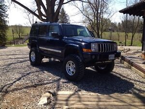 "Lifted jeep commander.  35"" tires and 5.7L hemi"