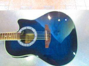 Guitare electro acoustique round back cutaway ! INCROYABLE !