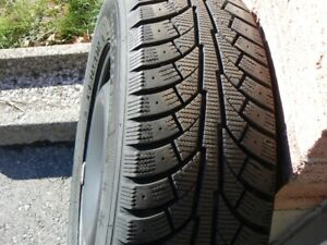 I am offering a Set of four Snow Tires on Rims