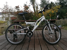 LIKE NEW RIDGE FULL SUSPENSION MOUNTAIN BIKE IN IMMACULATE CONDITION.