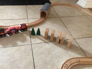 Melissa and Doug wooden train set.