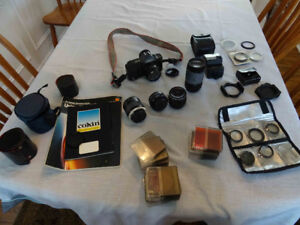 Cannon T-70 35mm Camera Lenses and accessories