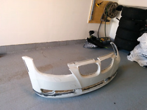 OEM e92 3 series coupe BMW front bumper and nozzle cover