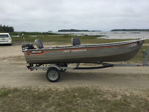 Ready to go 14 ft aluminum boat, motor, and trailer