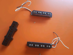 pair of Fender Mexican Jazz bass pickups