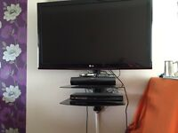 TV Wall Mount With 2 Glass Shelves.