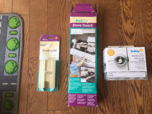 Childproofing items - stove guard, handle lock, finger guard