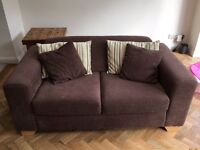 Brown sofa and cushions