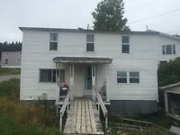 Two-story house over looking ocean for sale suitable for cabin!