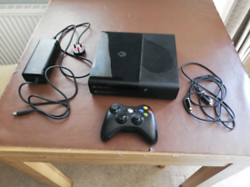 Xbox 360, wireless controller and 7 games.