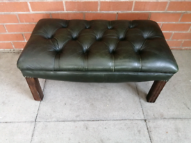 A Dark Green Leather Chesterfield Foot Stool