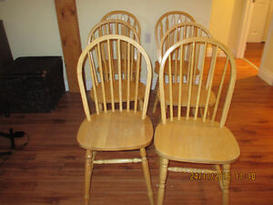 6 Solid wood chairs Good used condition. Will Seperate.