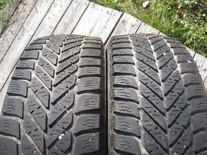 Two goodyear Ultragrip ice tires 185 65 14 & 4x100 steel rims