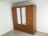 Solid wooden four door wardrobe