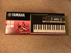 Yamaha PSR E243 61-Key Portable Keyboard with stand never used.